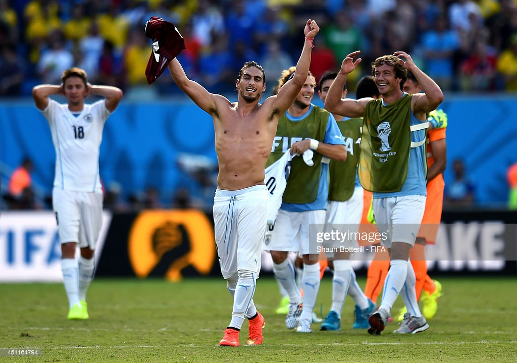 Martin Caceres and Uruguay players celebrate the 1-0 win after the 2014 FIFA World Cup Brazil Group D match between Italy and Uruguay at Estadio das Dunas on June 24, 2014 in Natal, Brazil.