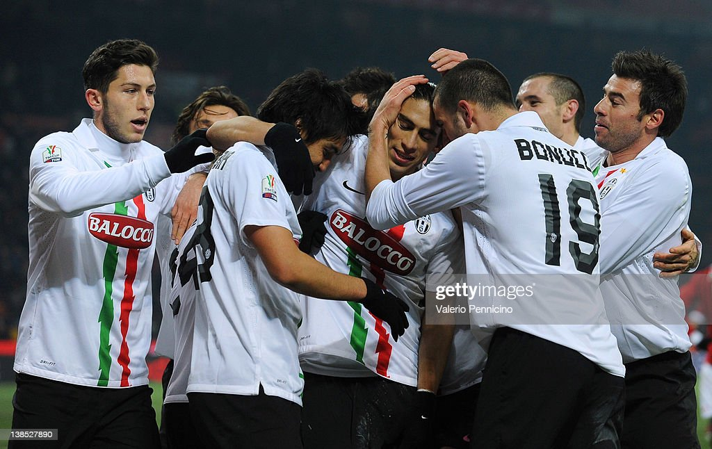 Martin Caceres (C) of Juventus FC celebrates with his team-mates after scoring the second goal during the Tim Cup match between AC Milan and Juventus FC at Giuseppe Meazza Stadium on February 8, 2012 in Milan, Italy.