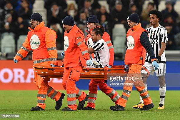 Martin Caceres of Juventus FC is helped from the pitch after sustaining an injury during the Serie A match between Juventus FC and Genoa CFC at...