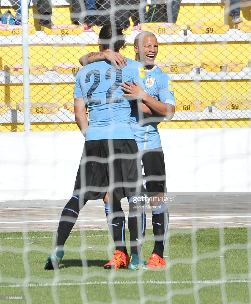 Martin Caceres (L) of Uruguay celebrates the opening goal with teammate Carlos Sanchez (R) during a match between Bolivia and Uruguay as part of FIFA 2018 World Cup Qualifier at Hernando Siles Stadium on October 08, 2015 in La Paz, Bolivia.