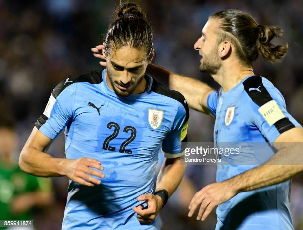 Martin Caceres of Uruguay celebrates with Gaston Silva after scoring his team's first goal during a match between Uruguay and Bolivia as part of FIFA...