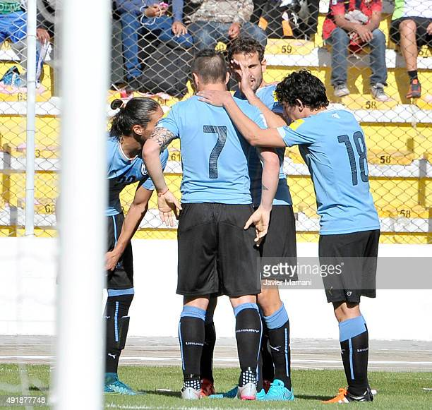 Martin Caceres of Uruguay celebrates with teammates after scoring the opening goal during a match between Bolivia and Uruguay as part of FIFA 2018...