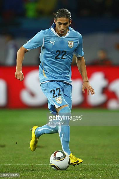 Martin Caceres of Uruguay in action during the 2010 FIFA World Cup South Africa Third Place Playoff match between Uruguay and Germany at The Nelson...