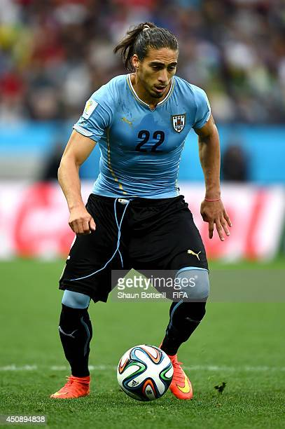 Martin Caceres of Uruguay in action during the 2014 FIFA World Cup Brazil Group D match between Uruguay and England at Arena de Sao Paulo on June 19...