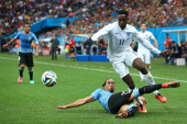 Martin Caceres of Uruguay tackles Danny Welbeck of England during the 2014 FIFA World Cup Brazil Group D match between Uruguay and England at Arena...