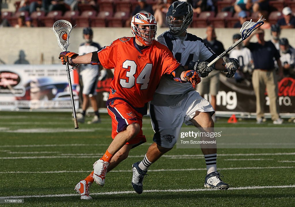 Martin Cahill #34 of the Hamilton Nationals runs with the ball during Major League Lacrosse game action against Steven Brooks #44 of the Chesapeake Bayhawks on June 29, 2013 at Ron Joyce Stadium in Hamilton, Ontario, Canada.