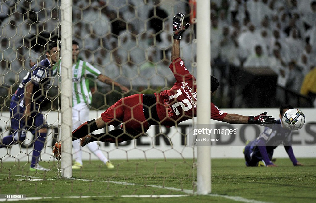 Martin Campaña Goalkeeper of Defensor Sporting pulls of a safe during a quarterfinal match between Atletico Nacional and Defensor Sporting as part of Copa Bridgestone Libertadores 2014 at Atanasio Girardot Stadium on May 08, 2014 in Medellin, Colombia.