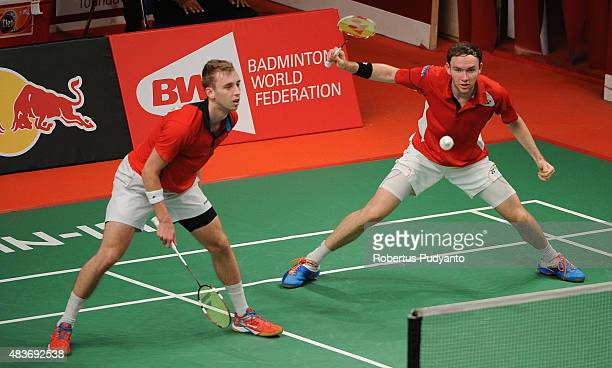 Martin Campbell and Patrick Machugh of Scotland compete against Kim Gi Jung and Kim Sa Rang of Korea in the 2015 Total BWF World Championship at...
