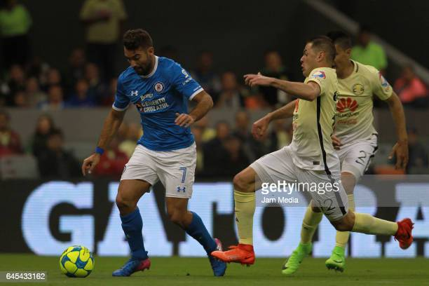 Martin Cauteruccio of Cruz Azul fights for the ball with Pablo Aguilar of America during the 8th round match between America and Cruz Azul as part of...