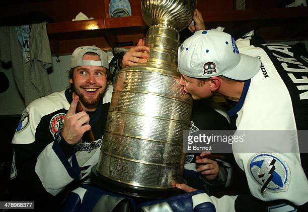 Martin Cibak and Stan Neckar of the Tampa Bay Lightning celebrate in the locker room with the Stanley Cup after defeating the Calgary Flames in Game...