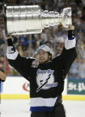 Martin Cibak of the Tampa Bay Lightning holds the Stanley Cup Trophy above his head after the victory over the Calgary Flames in Game seven of the...