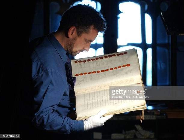Martin Clayton curator of the print room in Windsor Castle prepares a book containing signatures and seals of negotiators involved in the treaty of...