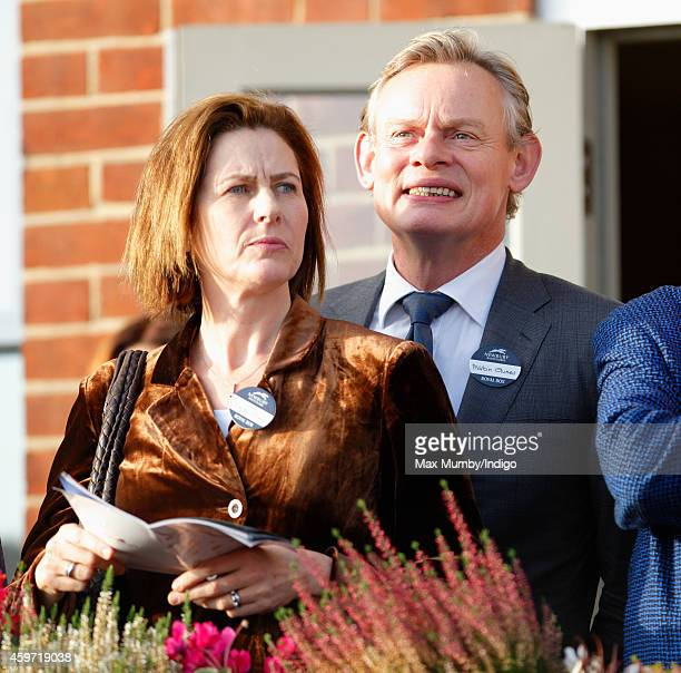 Martin Clunes and Philippa Braithwaite watch the racing as they attend the Hennessy Gold Cup race meeting at Newbury Racecourse on November 29 2014...