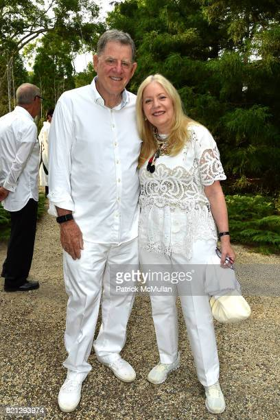 Martin Cohen and Michele Cohen attend Boom The Cosmic LongHouse Benefit at LongHouse Reserve on July 22 2017 in East Hampton New York