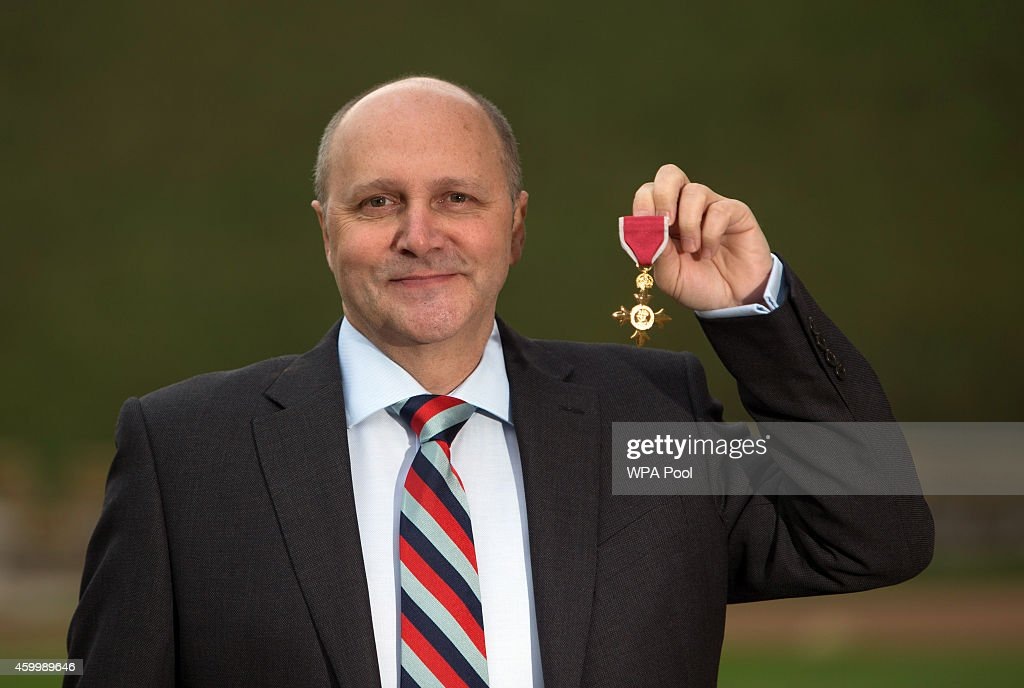 Martin Colclough, a former member of the Parachute Regiment and now head of sports recovery at the Help For Heroes charity after being awarded an OBE for services to disability sport in the Armed Forces by Queen Elizabeth II following an investiture ceremony at Windsor Castle on December 5, 2014 in Windsor, England.