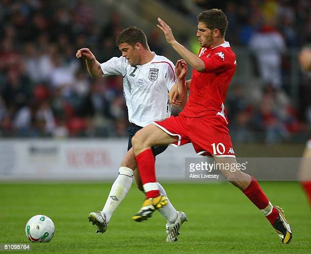 Martin Cranie of England U21 holds off a challenge from Ched Evans of Wales U21 during the Nationwide Under 21 International Friendly between Wales...