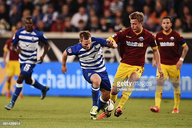 Martin Dausch of MSV Duisburg is challenged by Hauke Wahl of SC Paderborn during the Second Bundesliga match between MSV Duisburg and SC Paderborn at...