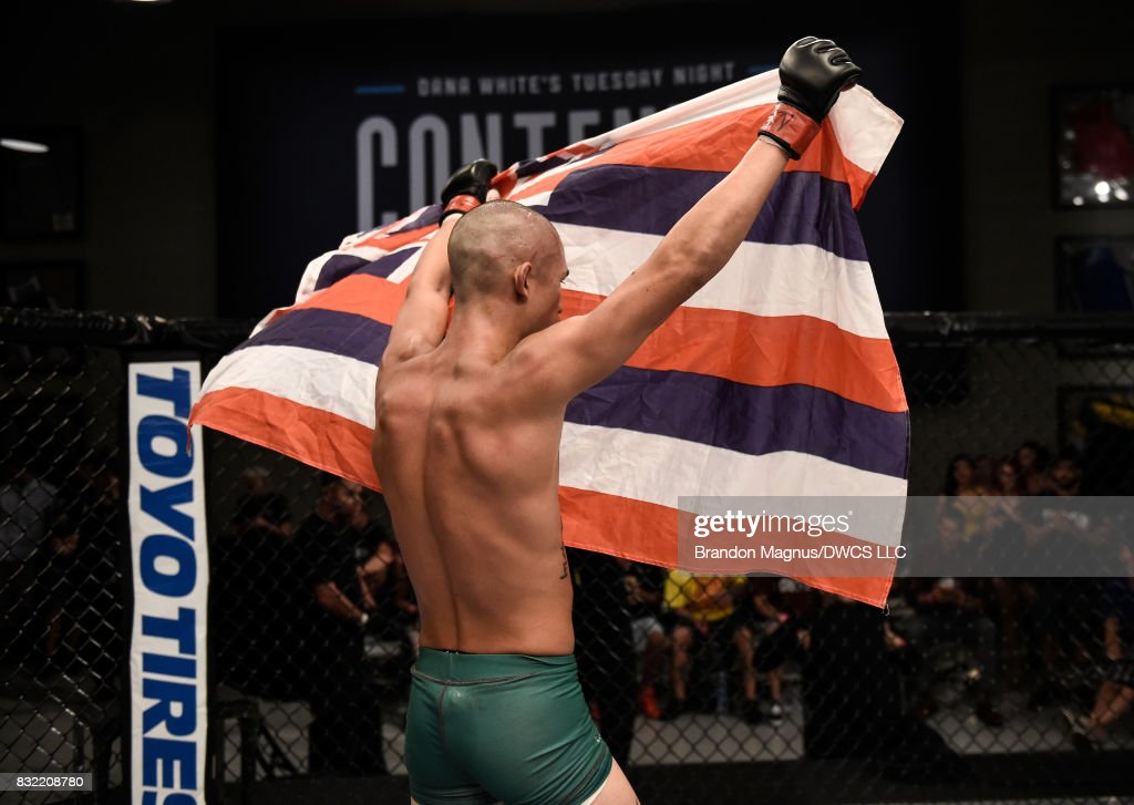 Martin Day raises his flag after facing Jaime Alvarez in their flyweight bout during Dana White's Tuesday Night Contender Series at the TUF Gym on August 15, 2017 in Las Vegas, Nevada.