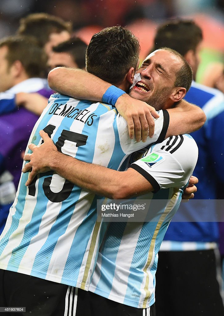 Martin Demichelis (L) and Pablo Zabaleta of Argentina celebrate after defeating the Netherlands in a penalty shootout during the 2014 FIFA World Cup Brazil Semi Final match between the Netherlands and Argentina at Arena de Sao Paulo on July 9, 2014 in Sao Paulo, Brazil.