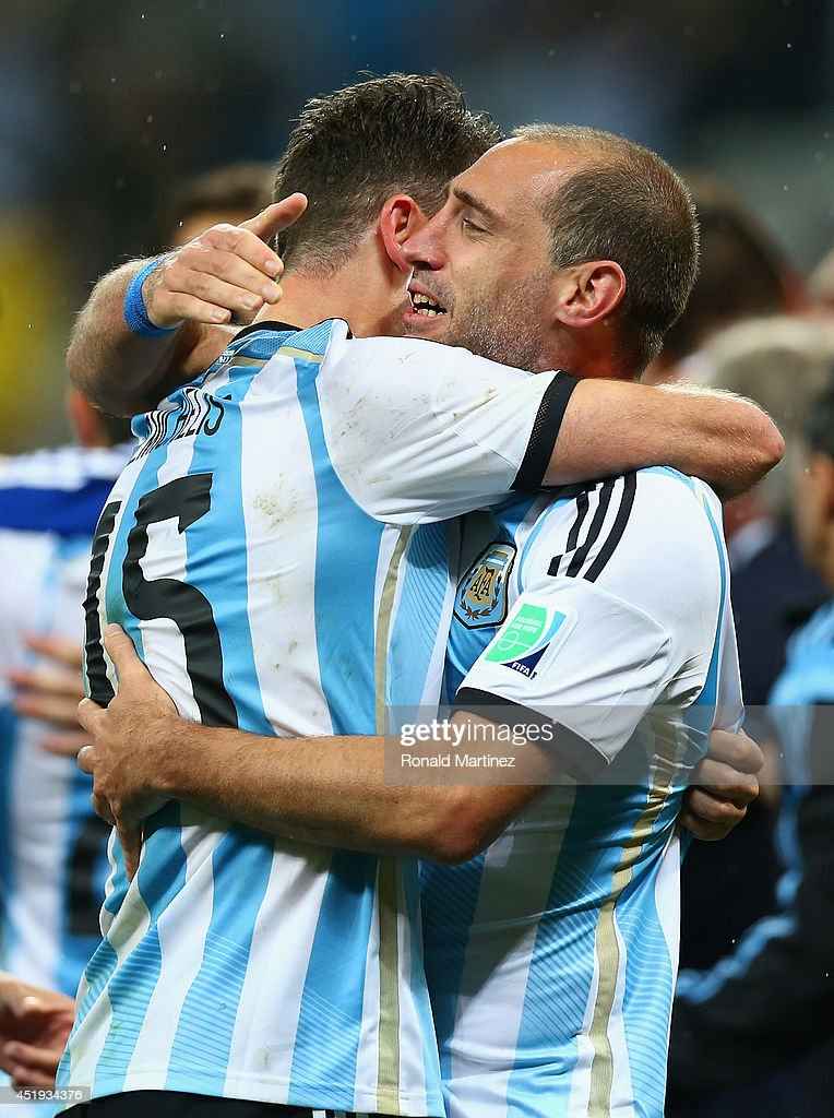 Martin Demichelis and Pablo Zabaleta of Argentina celebrate victory in a penalty shootout during the 2014 FIFA World Cup Brazil Semi Final match between the Netherlands and Argentina at Arena de Sao Paulo on July 9, 2014 in Sao Paulo, Brazil.