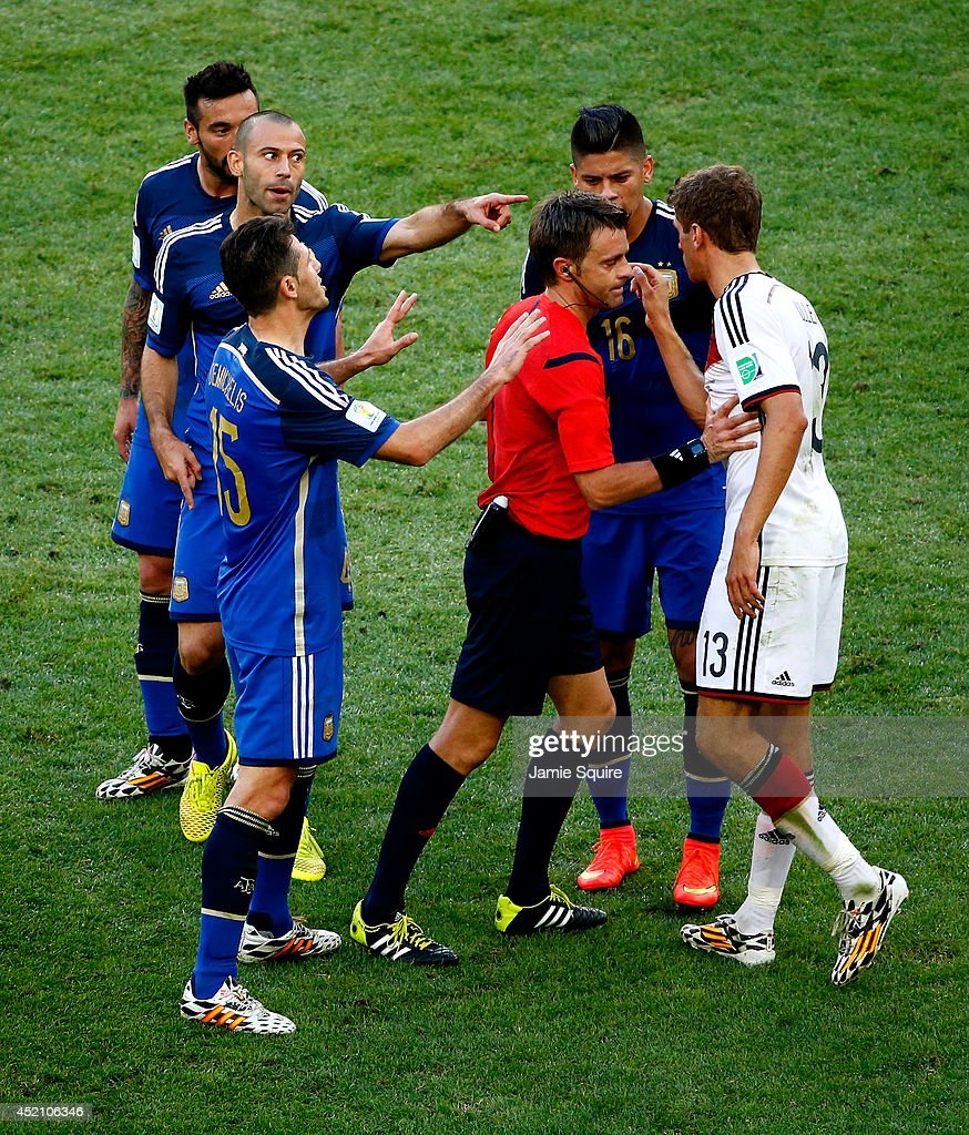 Martin Demichelis, Ezequiel Lavezzi, Javier Mascherano and Marcos Rojo of Argentina clash with Thomas Mueller of Germany as referee Nicola Rizzoli intervenes during the 2014 FIFA World Cup Brazil Final match between Germany and Argentina at Maracana on July 13, 2014 in Rio de Janeiro, Brazil.