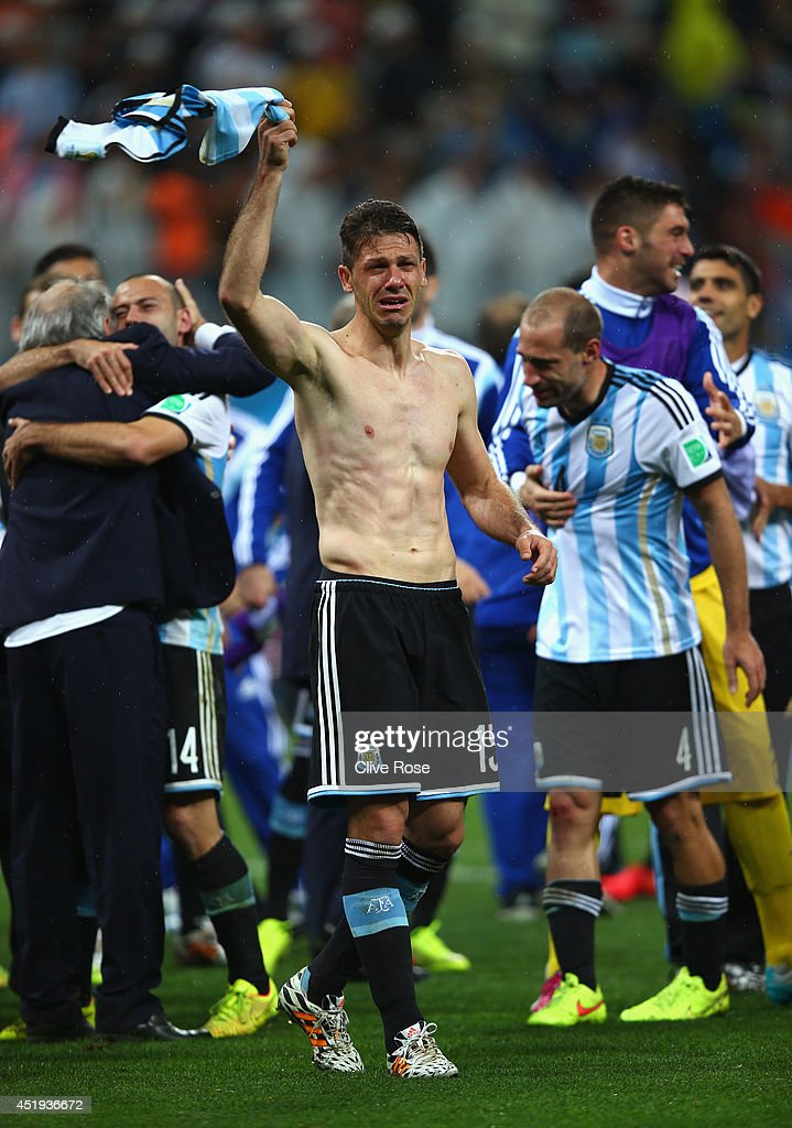 Martin Demichelis of Argentina celebrates defeating the Netherlands in a shootout during the 2014 FIFA World Cup Brazil Semi Final match between the Netherlands and Argentina at Arena de Sao Paulo on July 9, 2014 in Sao Paulo, Brazil.