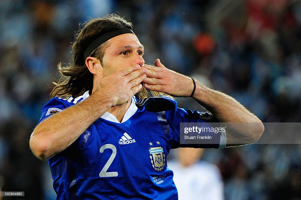 Martin Demichelis of Argentina celebrates scoring the opening goal during the 2010 FIFA World Cup South Africa Group B match between Greece and Argentina at Peter Mokaba Stadium on June 22, 2010 in Polokwane, South Africa.