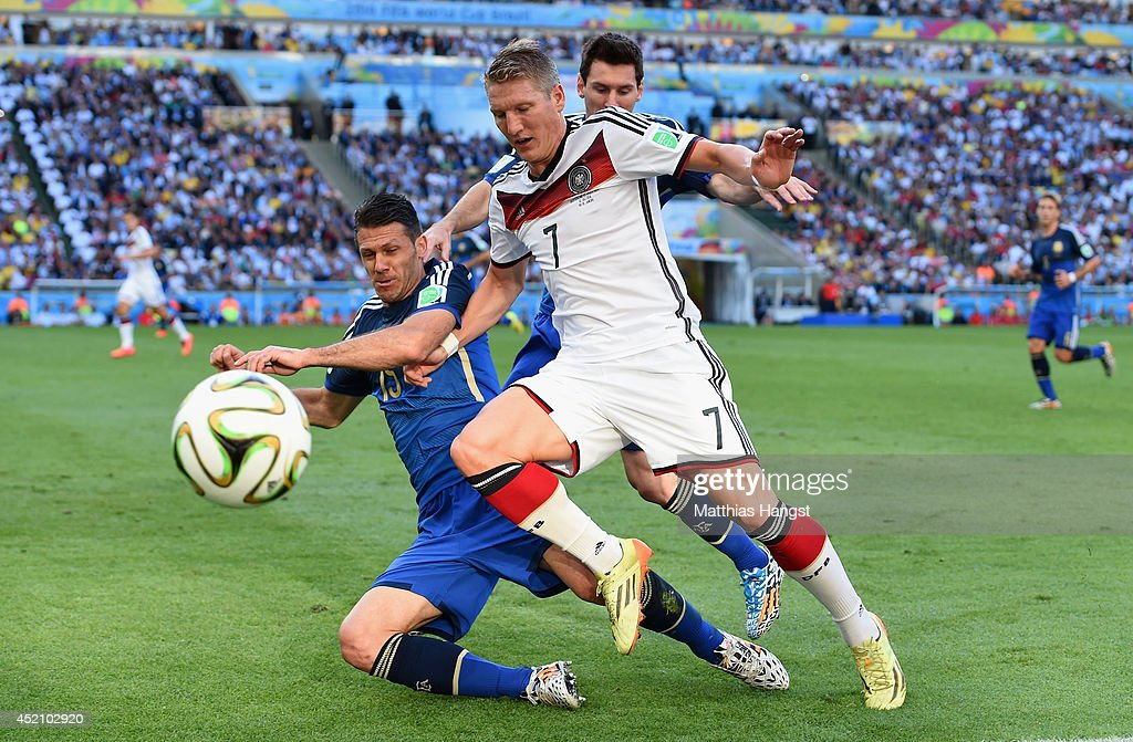 Martin Demichelis of Argentina challenges Bastian Schweinsteiger of Germany during the 2014 FIFA World Cup Brazil Final match between Germany and Argentina at Maracana on July 13, 2014 in Rio de Janeiro, Brazil.