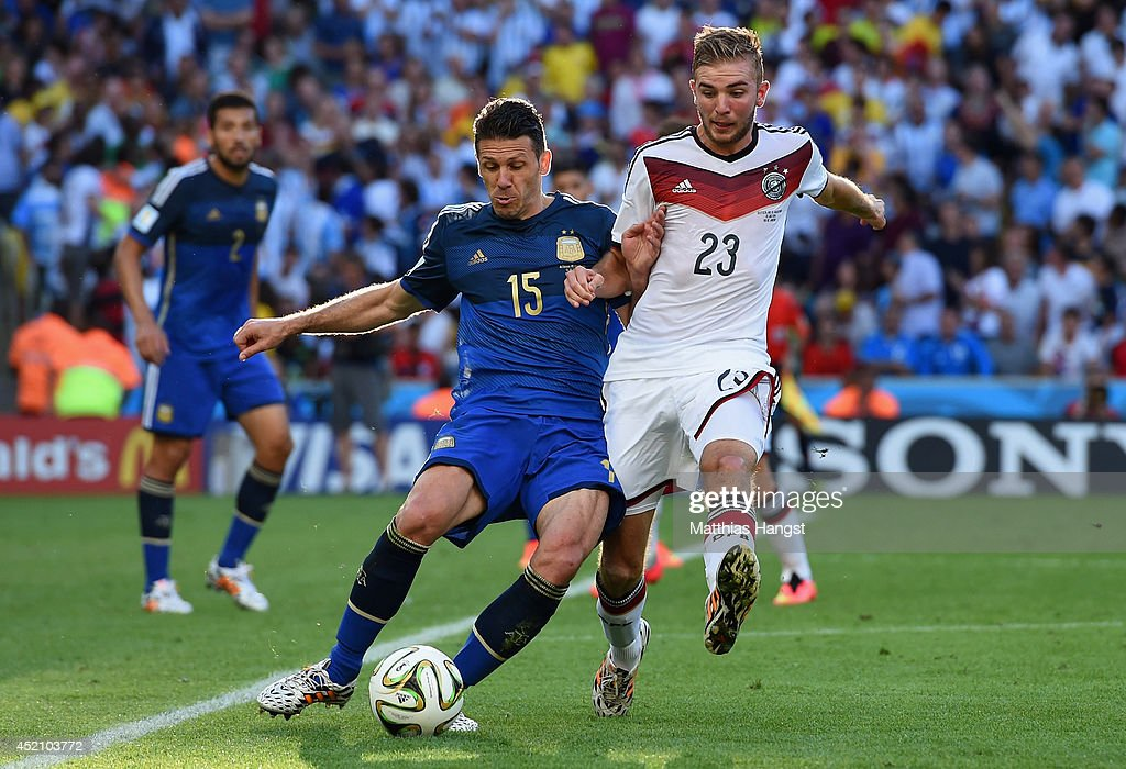 Martin Demichelis of Argentina is challenged by Christoph Kramer of Germany during the 2014 FIFA World Cup Brazil Final match between Germany and Argentina at Maracana on July 13, 2014 in Rio de Janeiro, Brazil.