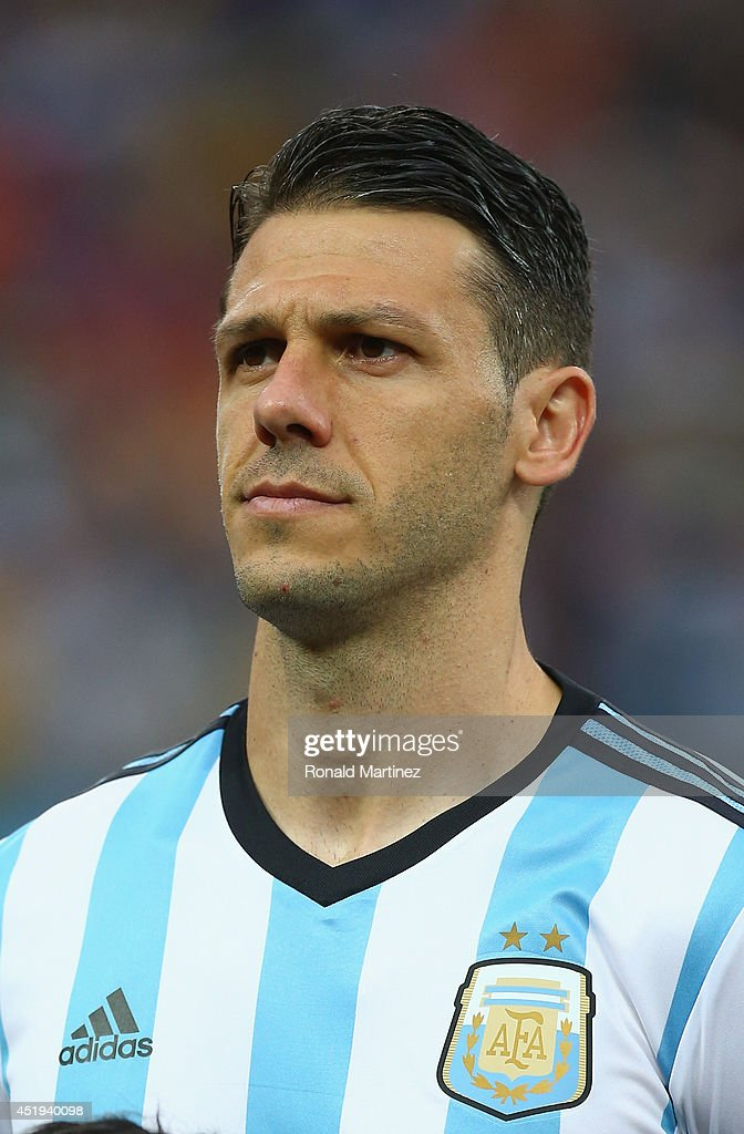 Martin Demichelis of Argentina looks on during the National Anthem prior to the 2014 FIFA World Cup Brazil Semi Final match between the Netherlands and Argentina at Arena de Sao Paulo on July 9, 2014 in Sao Paulo, Brazil.
