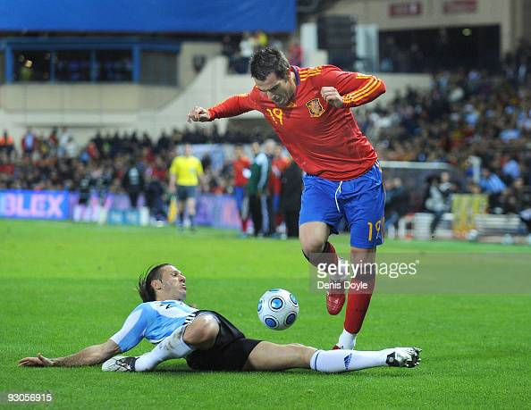 Martin Demichelis of Argentina tackles Alvaro Negredo of Spain during the International friendly match between Argentina and Spain at the Vicente...