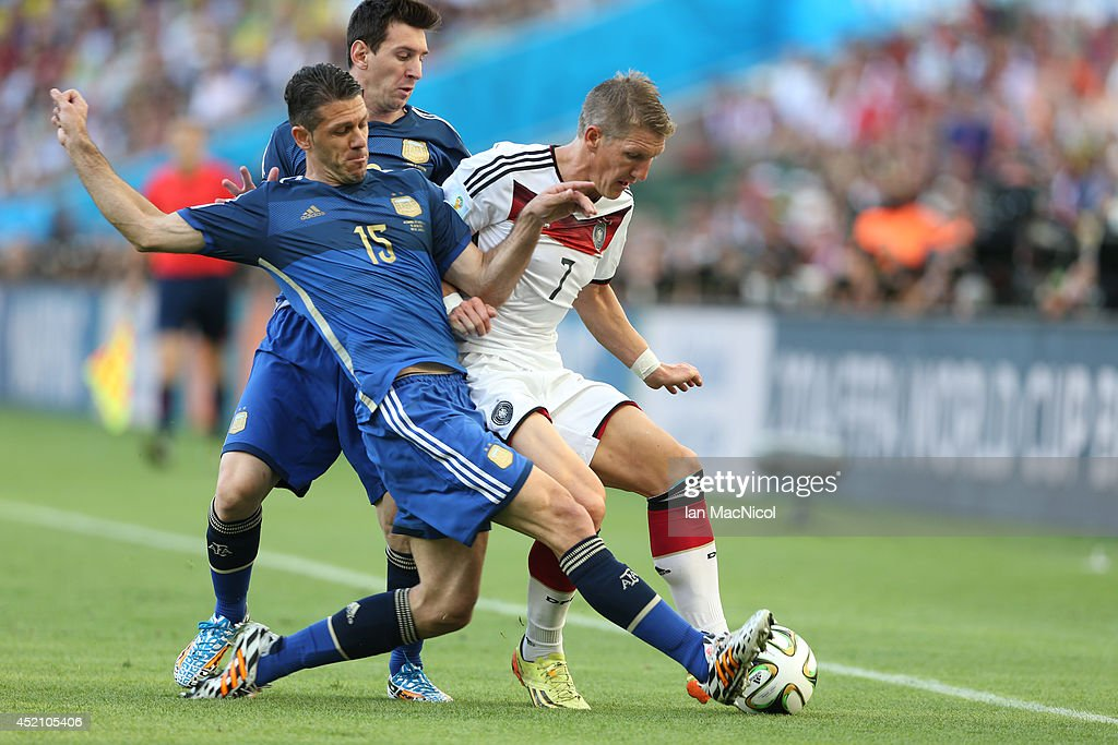 Martin Demichelis of Argentina vies with Bastian Schweinsteiger of Germany during the 2014 World Cup final match between Germany and Argentina at The Maracana Stadium on July 13, 2014 in Rio de Janeiro, Brazil.