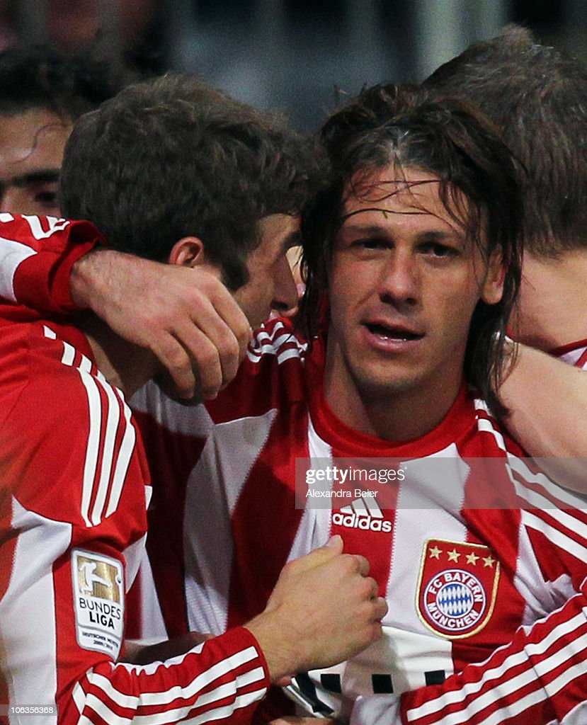 Martin Demichelis of Bayern Muenchen celebrates his first goal with his teammate Thomas Mueller (L) during the Bundesliga match between FC Bayern Muenchen and SC Freiburg at Allianz Arena on October 29, 2010 in Munich, Germany.