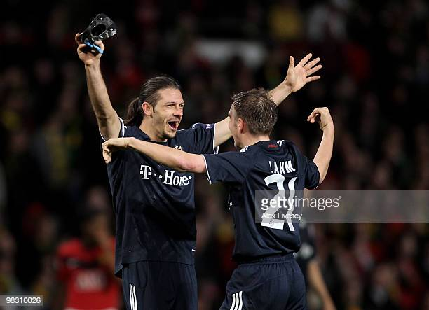 Martin Demichelis of Bayern Muenchen celebrates with team mate Philipp Lahm at the end of the UEFA Champions League Quarter Final second leg match...