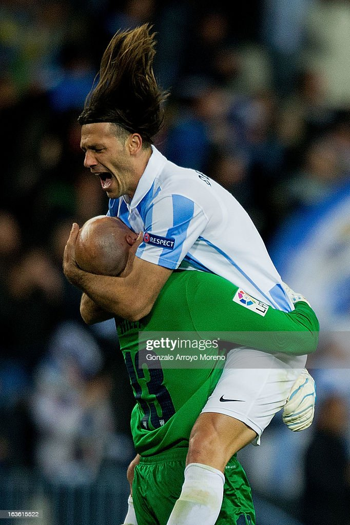 Martin Demichelis of Malaga CF celebrates their first goal scored by his teammate Isco with goalkeeper Wilfredo Caballero during the UEFA Champions...