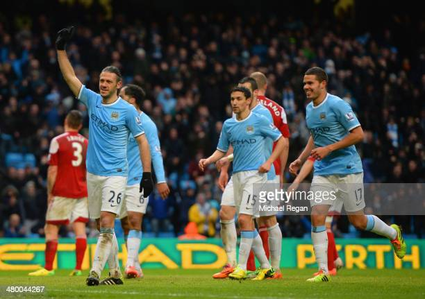 Martin Demichelis of Manchester City celebrates scoring their fifth goal with Jack Rodwell of Manchester City during the Barclays Premier League...