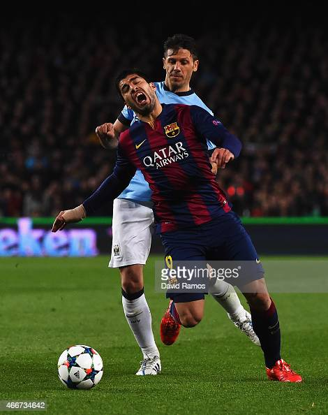 Martin Demichelis of Manchester City challenges Luis Suarez of Barcelona during the UEFA Champions League Round of 16 second leg match between...