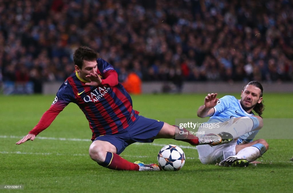 <a gi-track='captionPersonalityLinkClicked' href=/galleries/search?phrase=Martin+Demichelis&family=editorial&specificpeople=240330 ng-click='$event.stopPropagation()'>Martin Demichelis</a> of Manchester City fouls <a gi-track='captionPersonalityLinkClicked' href=/galleries/search?phrase=Lionel+Messi&family=editorial&specificpeople=453305 ng-click='$event.stopPropagation()'>Lionel Messi</a> of Barcelona to concede a penalty and is subsequently sent off during the UEFA Champions League Round of 16 first leg match between Manchester City and Barcelona at the Etihad Stadium on February 18, 2014 in Manchester, England.
