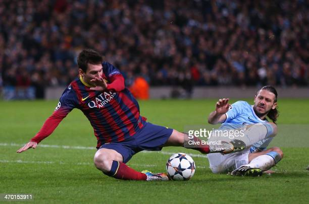Martin Demichelis of Manchester City fouls Lionel Messi of Barcelona to concede a penalty and is subsequently sent off during the UEFA Champions...