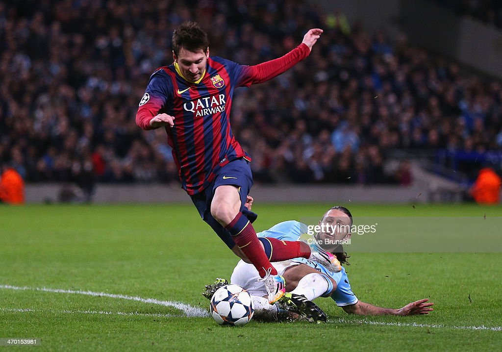 Martin Demichelis of Manchester City fouls Lionel Messi of Barcelona to concede a penalty and is subsequently sent off during the UEFA Champions League Round of 16 first leg match between Manchester City and Barcelona at the Etihad Stadium on February 18, 2014 in Manchester, England.