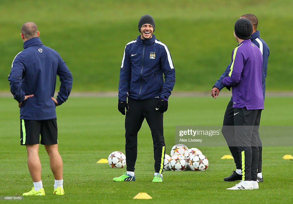<a gi-track='captionPersonalityLinkClicked' href=/galleries/search?phrase=Martin+Demichelis&family=editorial&specificpeople=240330 ng-click='$event.stopPropagation()'>Martin Demichelis</a> of Manchester City laughs during a training session at the Manchester City Football Academy on November 24, 2014 in Manchester, United Kingdom.