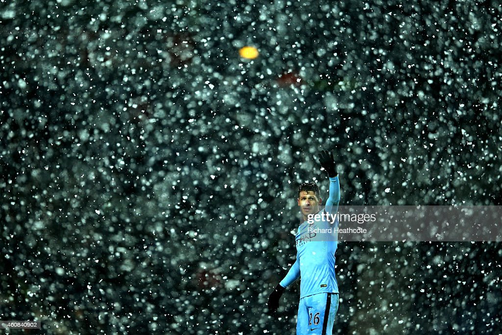 <a gi-track='captionPersonalityLinkClicked' href=/galleries/search?phrase=Martin+Demichelis&family=editorial&specificpeople=240330 ng-click='$event.stopPropagation()'>Martin Demichelis</a> of Manchester City signals as snow falls during the Barclays Premier League match between West Bromwich Albion and Manchester City at The Hawthorns on December 26, 2014 in West Bromwich, England.