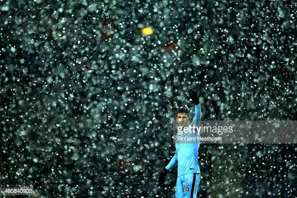 Martin Demichelis of Manchester City signals as snow falls during the Barclays Premier League match between West Bromwich Albion and Manchester City...