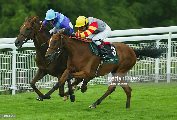 Martin Dwyer and Persian Punch get the better of the Darryll Holland ridden Jardines Lookout to land The Lady O Goodwood Cup Race run on the third...