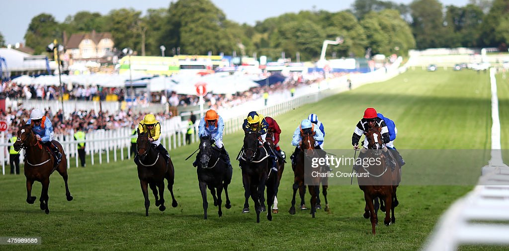 Martin Dwyer (R) rides Code Red to win The Investec Surrey Stakes at Epsom racecourse on June 05, 2015 in Epsom, England.