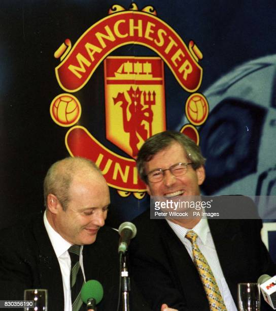 Martin Edwards Chief Executive of Manchester United with fellow director Peter Kenyon during news conference at Old Trafford following the...