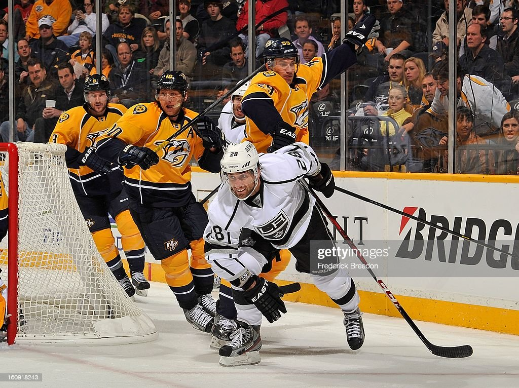 Martin Erat #10 and Roman Josi #59 of the Nashville Predators skate against Jarret Stoll #28 of the Los Angeles Kings at the Bridgestone Arena on February 7, 2013 in Nashville, Tennessee.