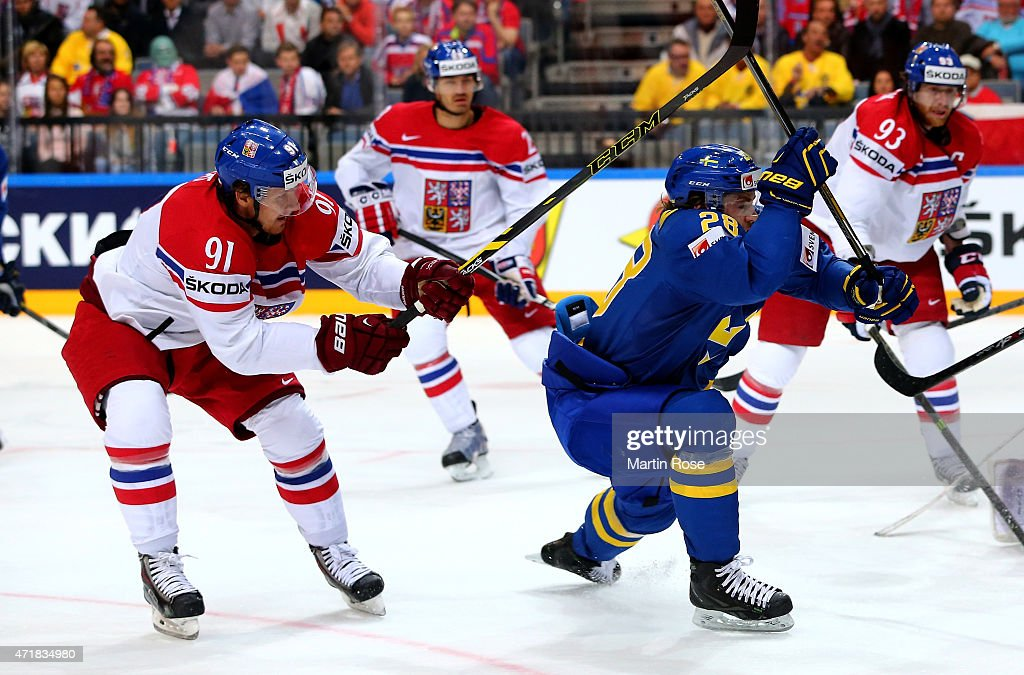 <a gi-track='captionPersonalityLinkClicked' href=/galleries/search?phrase=Martin+Erat&family=editorial&specificpeople=210561 ng-click='$event.stopPropagation()'>Martin Erat</a> (L) of Czech Republic and <a gi-track='captionPersonalityLinkClicked' href=/galleries/search?phrase=Elias+Lindholm&family=editorial&specificpeople=8613151 ng-click='$event.stopPropagation()'>Elias Lindholm</a> (R) of Sweden battle for the puck during the IIHF World Championship group A match between Czech Republic and Sweden at o2 Arena on May 1, 2015 in Prague, Czech Republic.