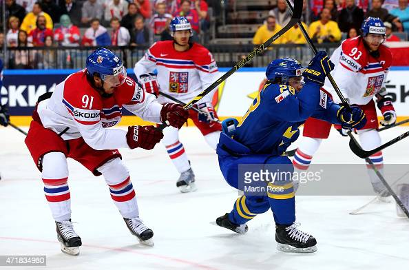 Martin Erat of Czech Republic and Elias Lindholm of Sweden battle for the puck during the IIHF World Championship group A match between Czech...