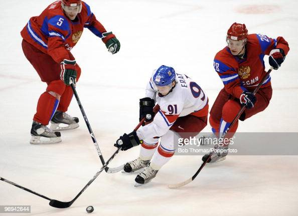 Martin Erat of the Czech Republic with Ilya Nikulin and Alexander Semin of Russia during the ice hockey men's preliminary game between Russia and...